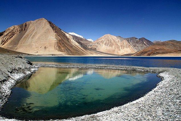 Pangong Lake located on the border of India and Tibet, is so clean you can see straight to the bottom.