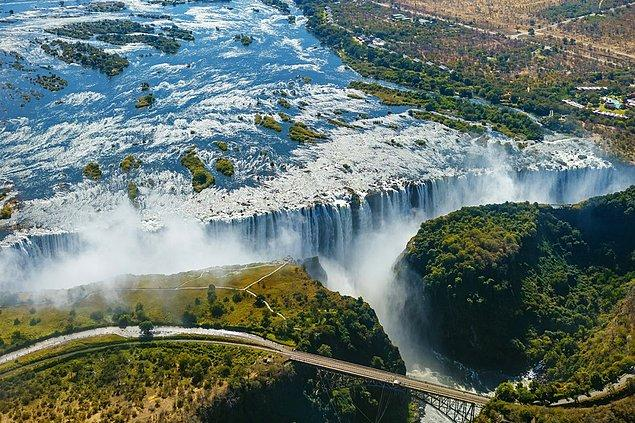 """Victoria Falls forms the border between Zambia and Zimbabwe, it is also known as """"The Smoke that Thunders"""". Bungee jumping, zip-lining, white water rafting, and helicopter flights are available on site."""