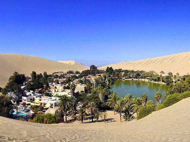 """Huacachina is a real oasis in the middle of the Peruvian desert! This is a resort town built around the natural lake in the Southwestern Ica Region. You can try """"sandboarding"""" here!"""