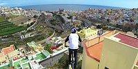BMX райдер проделывает сумасшедшие трюки на крышах