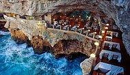 Итальянский ресторан внутри многовековой скалы с видом на море