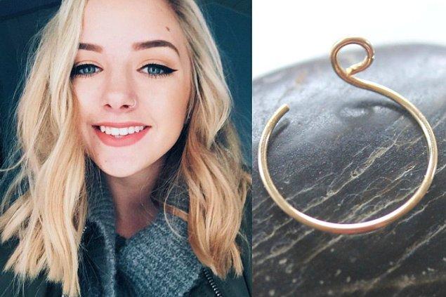 6. Bakın, acısız bir burun piercing'i kullanıcısı nasıl da gülümsüyor!
