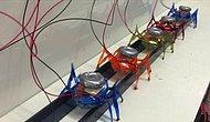 Super Strong Microrobots Pull 2-Ton Car
