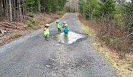 Little Scouts Who Have Crazy Fun With A Puddle