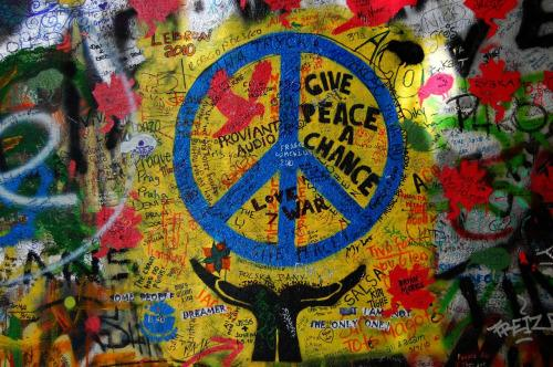 graffiti covered lennon wall will wake the hippie inside