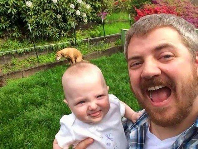 It was the perfect selfie until the dog decided to poo poo on the baby