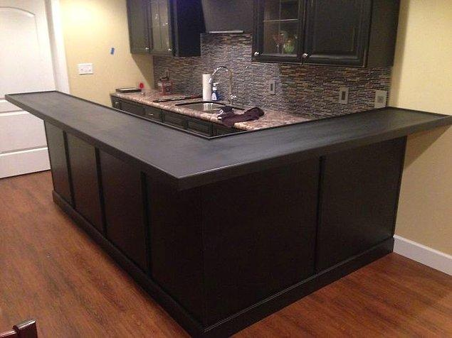 This guy designed and built a custom bottle cap bar top that would become the centerpiece of any room.