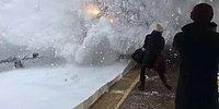 Spectacular Slow-Motion Video Shows The Moment A Train Covering Passengers In Snow!