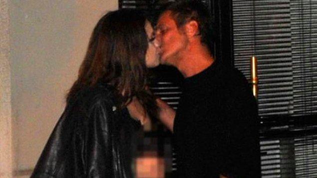 """1. Esmer bir güzelle öpüşürken görüntülenen Teoman, gazetecilere """"Sadece arkadaşım"""" açıklamasını yaptı."""