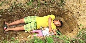 Китаец каждый день играет с дочерью в могиле, чтобы подготовить девочку к смерти