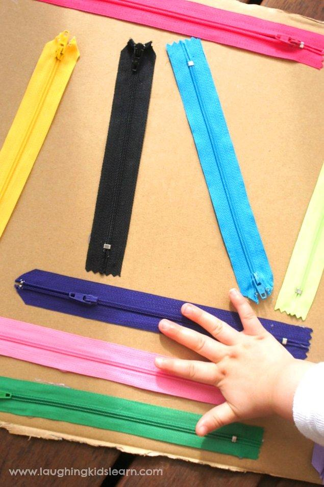 6. Çocuklara kendi başlarına giyinmeyi öğretirken kullanabileceğiniz fermuar tahtası.