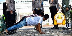 Чтобы другим неповадно было: Нарушителей масочного режима в Индонезии заставляют отжиматься и ... лежать в гробу