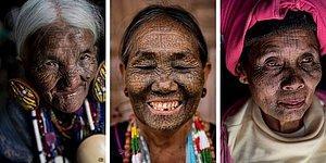 Последние из татуированных женщин племен в Мьянме, гордо позируют, демонстрируя традиционные чернильные знаки на лице, которые использовались для отпугивания похитителей