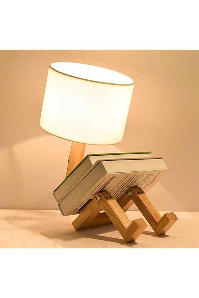 18. Gece yatmadan önce kitap okumayı sevenler için çok kullanışlı ve modern bir abajur.