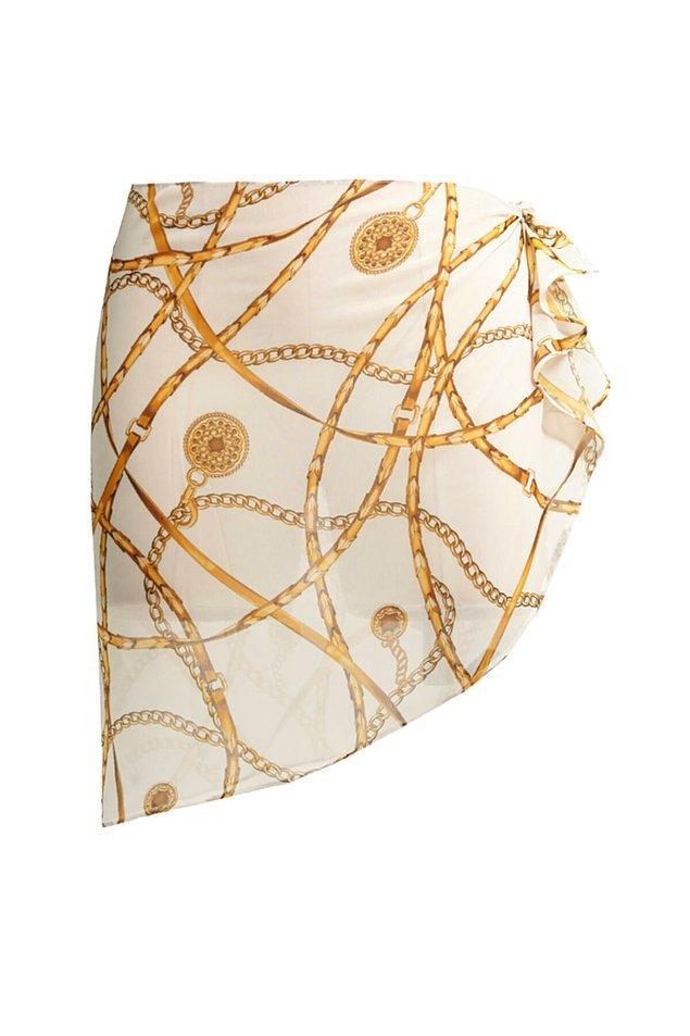 16. Gold desenli mini beyaz pareo da bronz teninize çok yakışacak...