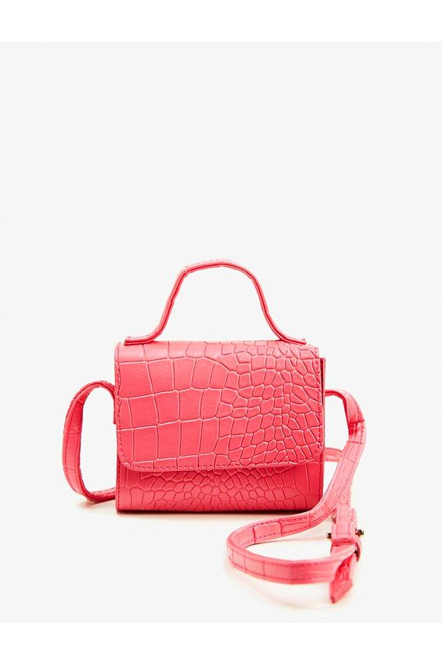 14. Pembe timsah derisi desenli çanta Koton marka...