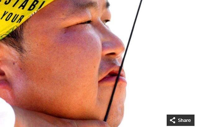 36. 23 Temmuz 2021'de Woojin Kim (KOR), Yumenoshima Okçuluk Alanında düzenlenen Tokyo 2020  Olimpiyatları sırasında erkekler bireysel okçuluk sıralamasında yarışıyor.