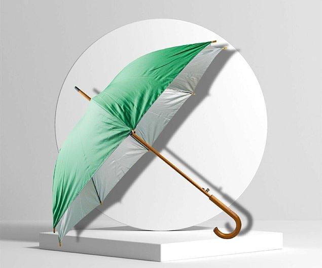 9. Bu sade ve sportif şemsiyenin rengi de çok hoş.