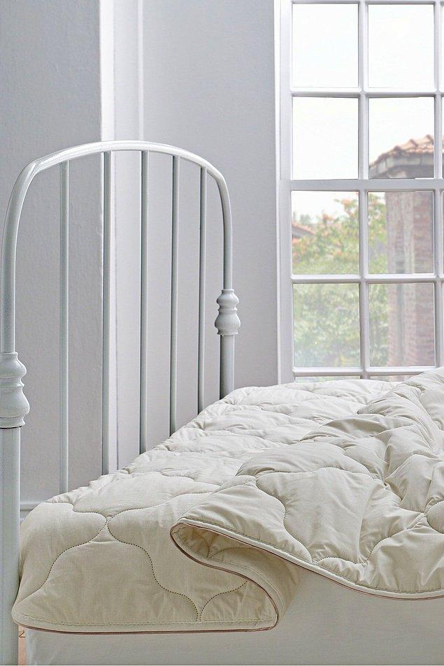 2. Yataş Superwashed çift kişilik yün yorgan yüksek kaliteli kumaşıyla uykuda doğallığı yaşatıyor.
